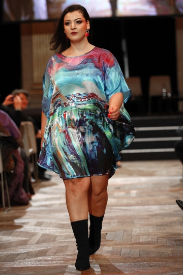 A plus-size model presents a creation during a fashion show as part of a day against fat phobia in Paris, France, Friday, Dec. 15, 2017. Paris, the seat of global luxury industries and one of the world's most image-conscious cities, is looking at its contradictions in the mirror with rising obesity levels and is launching a campaign against an often disregarded kind of discrimination: sizeism. (AP Photo/Christophe Ena)