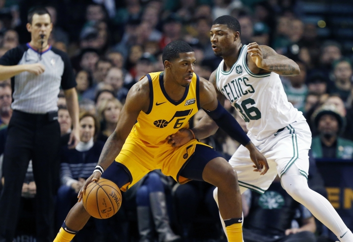 Utah Jazz's Joe Johnson (6) looks to move against Boston Celtics' Marcus Smart (36) during the third quarter of an NBA basketball game in Boston, Friday, Dec. 15, 2017. (AP Photo/Michael Dwyer)