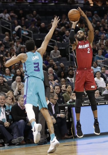 Miami Heat's Wayne Ellington (2) shoots over Charlotte Hornets' Jeremy Lamb (3) during the second half of an NBA basketball game in Charlotte, N.C., Friday, Dec. 15, 2017. (AP Photo/Chuck Burton)