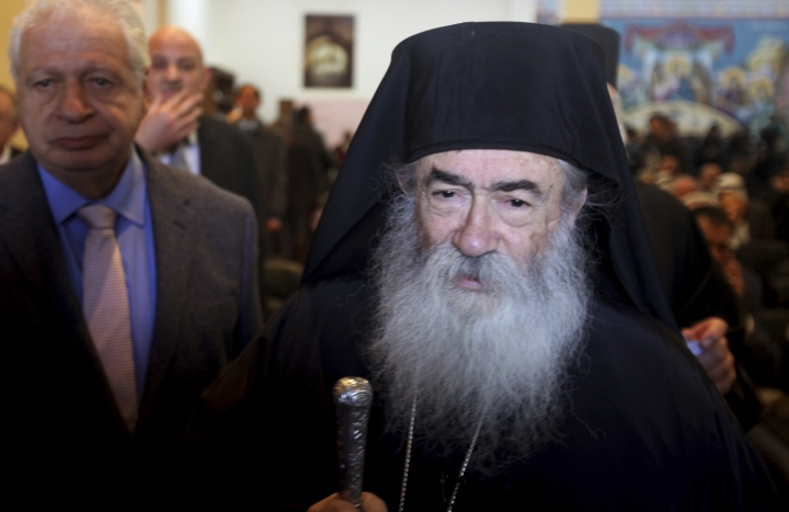 Monk Demyanos the head of the Saint Catherine's Monastery, walks during the reopening of Saint Catherine ancient Library on Saturday, Dec 16, 2017 in South Sinai, Egypt. The inauguration ceremony, attended by Egyptian and western officials, comes after three years of restoration work on the eastern side of the library that houses the world's second largest collection of early codices and manuscripts, outnumbered only by the Vatican Library, according to Monk Damyanos. (AP Photo/Samy Magdy)