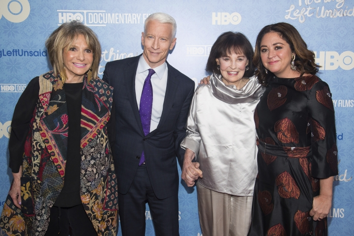 """FILE - In this April 4, 2016 file photo, Sheila Nevins, left, Anderson Cooper, Gloria Vanderbilt and Liz Garbus attend the premiere of """"Nothing Left Unsaid"""" at the Time Warner Center in New York. Nevins, who has run HBO's documentary unit for 38 years and has been a key gatekeeper in the making of its nonfiction films says she will be stepping down early in 2018. (Photo by Charles Sykes/Invision/AP, File)"""