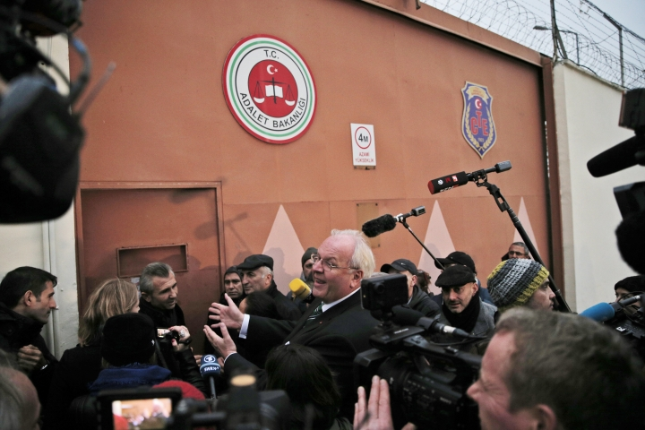 Germany's Ambassador in Turkey, Martin Erdmann, surrounded by members the media, tries to enter a prison to meet with German journalist Mesale Tolu, in Istanbul, Monday, Dec. 18, 2017. Tolu, 33, accused of engaging in terrorist propaganda and being a member of a banned left-wing group, was freed on bail during the second hearing in her trial earlier Monday, but her final release had been delayed. (AP Photo/Lefteris Pitarakis)