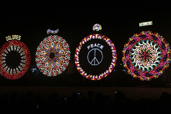 In this Saturday, Dec. 16, 2017, photo, giant lanterns display their intricate light patterns at the competition in Pampanga province, Philippines. Skillfully crafted giant lanterns light up the Filipino Christmas spirit in the Philippines province on Saturday, ahead of the festive holiday. Ten villages in Pampanga province took part in an annual giant lantern competition, proudly showcasing huge elaborate lanterns for everyone to see. (AP Photo/Iya Forbes)