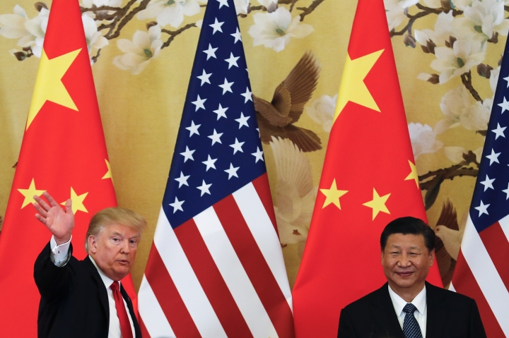 "FILE - In this Thursday, Nov. 9, 2017, file photo, U.S. President Donald Trump waves next to Chinese President Xi Jinping after attending a joint press conference at the Great Hall of the People in Beijing. China's main official news agency is warning U.S.-Chinese relations will face ""more pressure and challenges"" following President Donald Trump's decision to label Beijing a rival. (AP Photo/Andy Wong, File)"