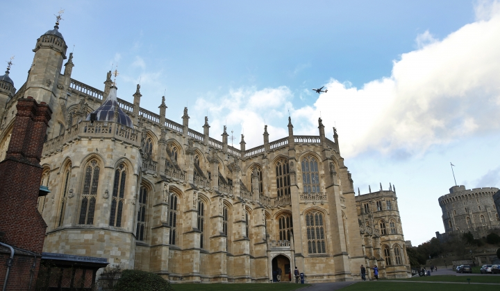 """FILE - This Nov. 28, 2017, file photo, shows a general view of St George's Chapel within the walls of of Windsor Castle, in Windsor, England. U.S. visitation to the United Kingdom has been booming and is expected to stay strong in 2018 thanks to the upcoming royal wedding of Prince Harry to American actress Meghan Markle at Windsor Castle, pilgrimages by U.S. fans of the Netflix series """"The Crown,"""" and the continued strength of the U.S. dollar against the pound. (AP Photo/Alastair Grant, file)"""
