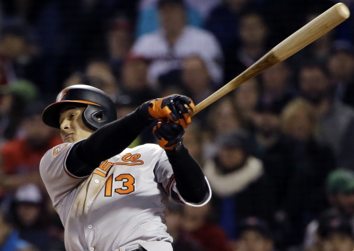FILE - In this Thursday, May 4, 2017 file photo, Baltimore Orioles' Manny Machado hits a three-run homer in the fourth inning of a baseball game against the Boston Red Sox at Fenway Park, Thursday, May 4, 2017, in Boston. The Los Angeles Dodgers will pay baseball's highest luxury tax for the fourth straight year and the New York Yankees owe a penalty for a 15th consecutive season. The Dodgers and Yankees vow to get below next year's tax threshold of $197 million. That would reset their base tax rate from 50 percent to 20 percent going into the 2018-19 offseason, when Bryce Harper, Manny Machado and possibly Clayton Kershaw head a potentially illustrious free-agent class. (AP Photo/Elise Amendola, File)