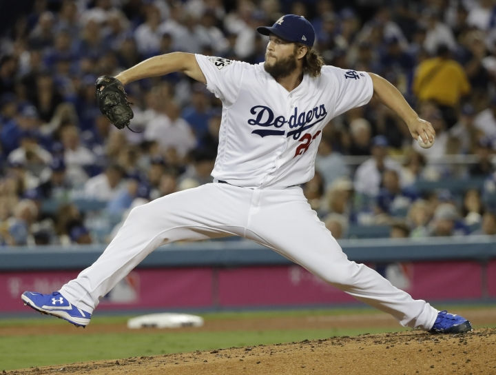 FILE - In this Wednesday, Nov. 1, 2017 file photo, Los Angeles Dodgers' Clayton Kershaw makes a relief appearance during the third inning of Game 7 of baseball's World Series against the Houston Astros in Los Angeles. The Los Angeles Dodgers will pay baseball's highest luxury tax for the fourth straight year and the New York Yankees owe a penalty for a 15th consecutive season, streaks that could end as the sport's biggest spenders slash payroll for 2018. (AP Photo/David J. Phillip, File)
