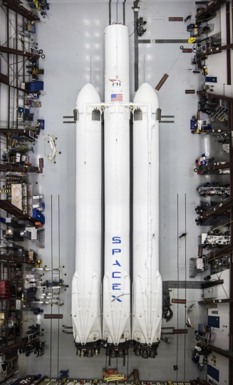 This photo made available by SpaceX on Wednesday, Dec. 20, 2017 shows the new Falcon Heavy rocket in a hangar at Cape Canaveral, Fla. It is scheduled for a test flight in January 2018. (SpaceX via AP)