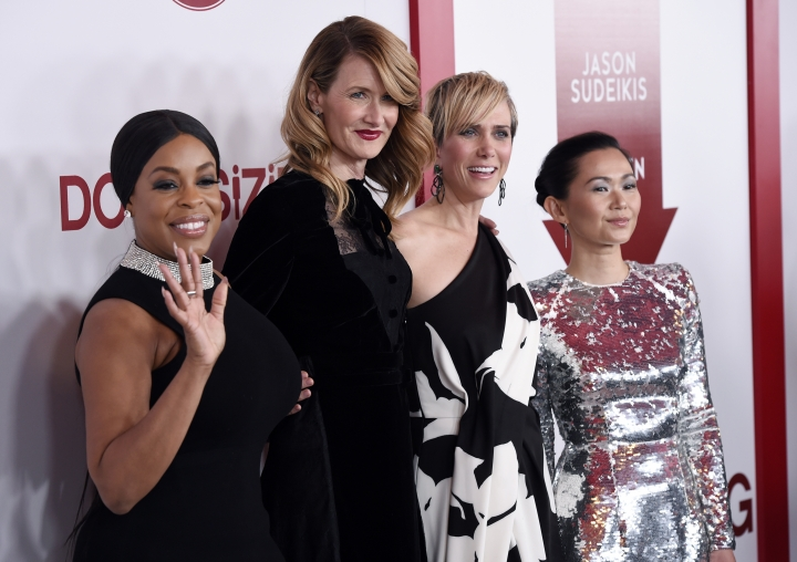 "From left, ""Downsizing"" cast members Niecy Nash, Laura Dern, Kristen Wiig and Hong Chau pose together at a special screening of the film at the Regency Village Theatre on Monday, Dec. 18, 2017, in Los Angeles. (Photo by Chris Pizzello/Invision/AP)"