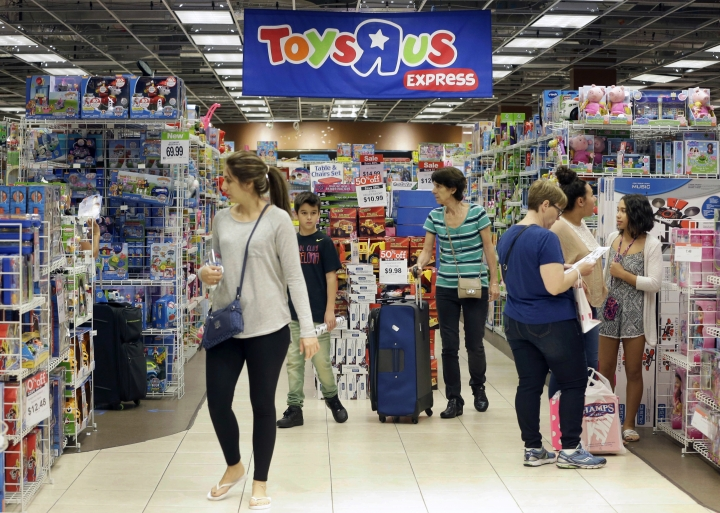 FILE - In this Friday, Nov. 25, 2016, file photo, shoppers browse at a Toys R Us store in Miami. The toys your kids unwrap this Christmas could invite hackers into your home. That Grinch-like warning comes from the FBI, which said this summer that toys connected to the internet could be a target for crooks who may listen in on conversations or use them to steal a child's personal information. (AP Photo/Alan Diaz, File)
