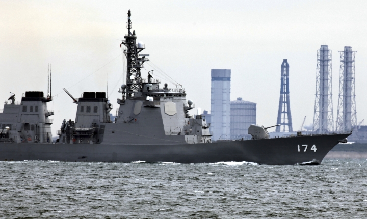 FILE - In this March 28, 2009, file photo, Japan Maritime Self-Defense Force's Aegis destroyer Kirishima sails off Yokosuka base, Japan, amid reports of North Korea's planned rocket launch. Japanese Prime Minister Shinzo Abe's Cabinet approved Japan's biggest 5.19 trillion yen ($46 billion) defense budget on Friday, Dec. 22, 2017, to bolster ballistic missile defense capability amid escalating threats from North Korea. Two planned Aegis Ashore systems are aimed at diversifying Japan's current two-step missile defense consisting of Patriot batteries and Aegis-equipped destroyers deployed in the Sea of Japan.(AP Photo/Junji Kurokawa, File)