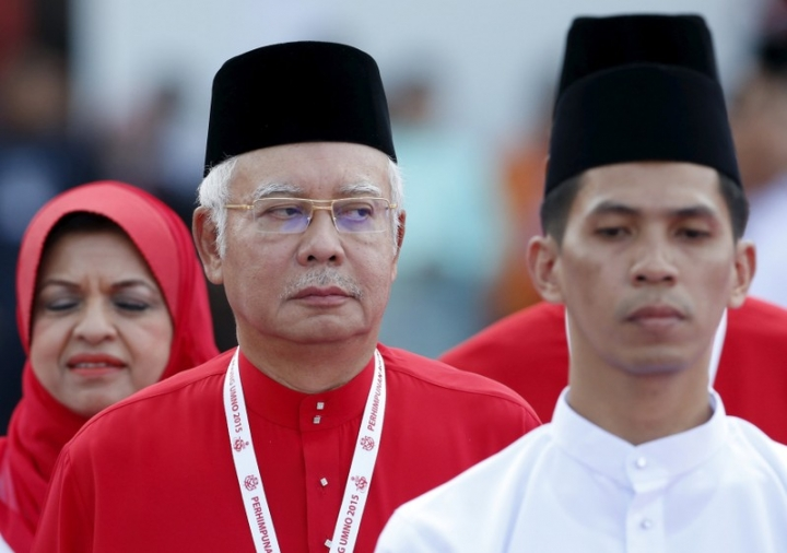 FILE PHOTO: Malaysia's Prime Minister Najib Razak inspects the United Malays National Organisation (UMNO) youth during the annual assembly at the Putra World Trade Centre in Kuala Lumpur, Malaysia, December 10, 2015. REUTERS/Olivia Harris/File Photo