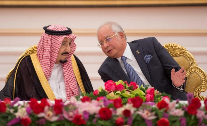 FILE PHOTO: Saudi Arabia's King Salman and Malaysia's Prime Minister Najib Razak attend a Memorandum of Understanding signing ceremony in Putrajaya, Malaysia, February 27, 2017. Bandar Algaloud/Courtesy of Saudi Royal Court/Handout via REUTERS/File Photo