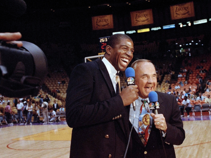 "FILE - In this Feb. 2, 1992, file photo, Earvin ""Magic"" Johnson, left, and veteran sportscaster Dick Enberg laugh during commentary before the Los Angeles Lakers-Chicago Bulls NBA basketball game in Inglewood, Calif. This was Johnson's debut as a sports commentator. Enberg, the sportscaster who got his big break with UCLA basketball and went on to call Super Bowls, Olympics, Final Fours and Angels and Padres baseball games, died Thursday, Dec. 21, 2017. He was 82. Engberg's daughter, Nicole, confirmed the death to The Associated Press. She said the family became concerned when he didn't arrive on his flight to Boston on Thursday, and that he was found dead at his home in La Jolla, a San Diego neighborhood. (AP Photo/Doug Pizac, File)"