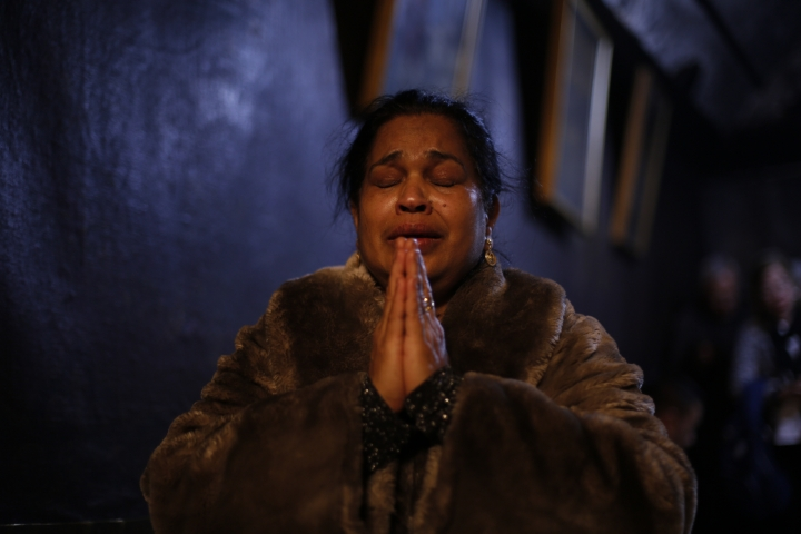 A worshipper prays inside the Church of the Nativity, built atop the site where Christians believe Jesus Christ was born, on Christmas Eve, in the West Bank City of Bethlehem, Sunday, Dec. 24, 2017. (AP Photo/Majdi Mohammed)