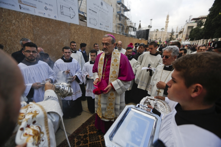 The Latin Patriarch of Jerusalem Pierbattista Pizzaballa arrives to the Church of the Nativity, built atop the site where Christians believe Jesus Christ was born, on Christmas Eve, in the West Bank City of Bethlehem, Sunday, Dec. 24, 2017. (AP Photo/Majdi Mohammed)