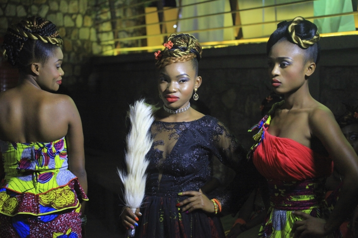 In this photo taken Saturday Dec. 23, 2017, Models pose for a photograph back stage before a fashion show in Beni Eastern Congo . Young Congolese designer Miki Sikabwe has trained in Rwanda, Burundi and Kenya, but hasn't gotten the chance to show her work locally in eastern Congo for years because of insecurity. (AP Photo/Al-Hadji Kudra Maliro)