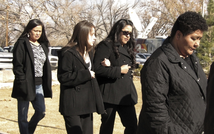 FILE - In this Jan. 14, 2010, file photo, Tanya Romans, right, is followed by unidentified family members attending the sentencing of a 10-year-old boy who pleaded guilty to negligent homicide in Romans husband's November 2008 killing, in St. Johns, Ariz. The boy who pleaded guilty to a negligent homicide charge is nearing the end of probation. (AP Photo/Felicia Fonseca, file)