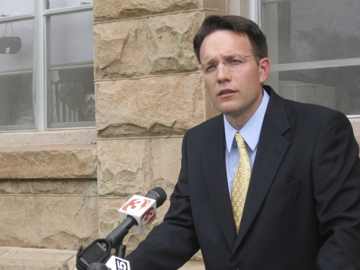 FILE - In this June 16, 2009, file photo, Apache County Attorney Michael Whiting speaks outside the courthouse in St. Johns, Ariz., to reporters about the case where Vincent Romero and Timothy Romans, of San Carlos, Ariz., were found fatally shot. Romero's 8-year-old son, who pleaded guilty to a negligent homicide charge in the 2008 killing, is nearing the end of probation. (AP Photo/Felicia Fonseca, File)