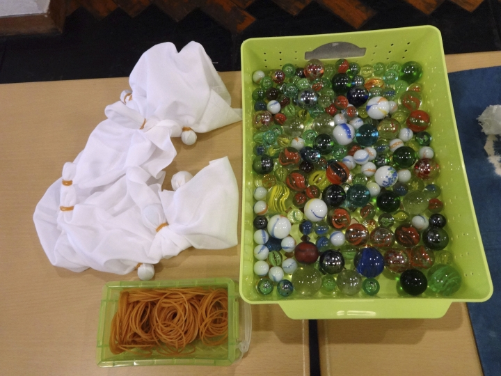 This Nov. 14, 2017 photo shows materials for shibori tie-dyeing and cloth ready for dyeing at Wanariya workshop in Tokyo. (Linda Lombardi via AP)