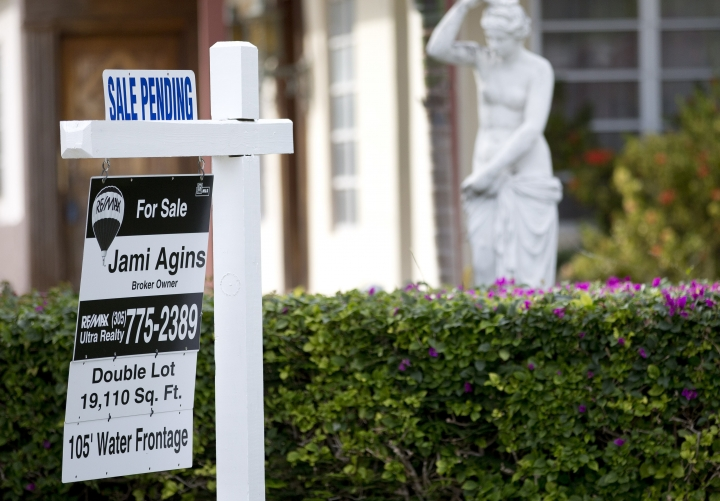 "FILE - In this Thursday, Jan. 8, 2015, file photo, a ""Sale Pending"" placard is placed atop a realty sign outside a home for sale in Surfside, Fla. On Wednesday, Dec. 27, 2017, the National Association of Realtors releases its November report on pending home sales, which are seen as a barometer of future purchases. (AP Photo/Wilfredo Lee, File)"