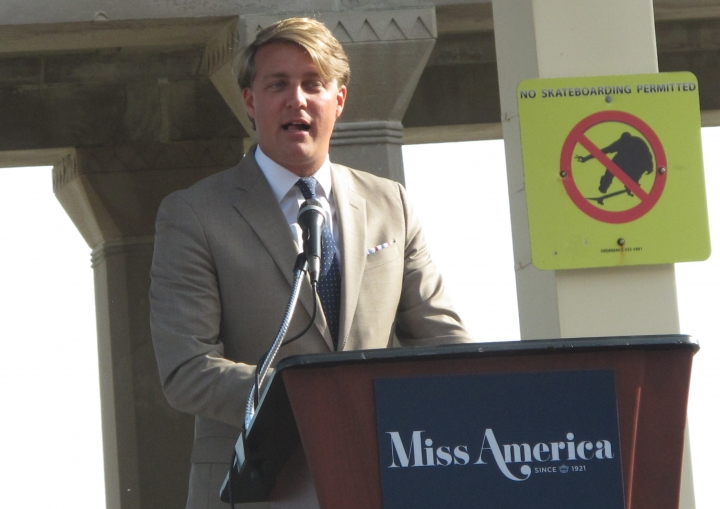 FILE- This Aug. 30, 2017, file photo shows Josh Randle, president of the Miss America Organization, speaking at a welcoming ceremony for pageant contestants in Atlantic City N.J. Trashed by emails sent by pageant officials, former Miss Americas will help choose the new leaders of the Miss America Organization. The group told The Associated Press Wednesday, Dec. 27, 2017, that it is enlisting the help of former Miss Americas and state directors to recommend the next generation of leaders for the pageant. The ensuing uproar led to Randle's resignation. (AP Photo/Wayne Parry, File)