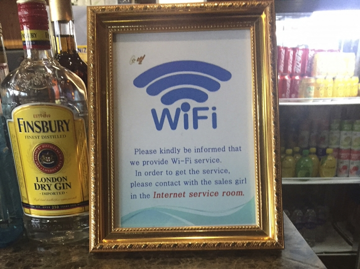 This Dec. 23, 2017, photo, shows a sign for the new WiFi service being offered in the departures lobby of Pyongyang's international airport. Despite being one of the least Internet-friendly countries in the world, North Korea's main Internet provider recently set up an airport WiFi network that is available to travelers who have cleared customs. Access to WiFi and the Internet in general remains beyond the reach of most North Koreans. (AP photo/Eric Talmadge)