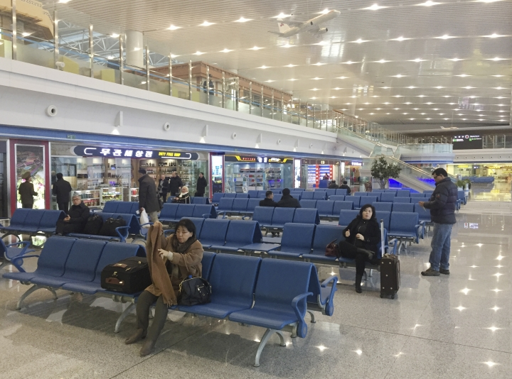 In this Dec. 23, 2017, photo, passengers wait for their flights in the departures lobby of Pyongyang's international airport. Despite being one of the least Internet-friendly countries in the world, North Korea's main Internet provider recently set up an airport WiFi network that is available to travelers who have cleared customs. Access to WiFi and the Internet in general remains beyond the reach of most North Koreans. (AP Photo/Eric Talmadge)