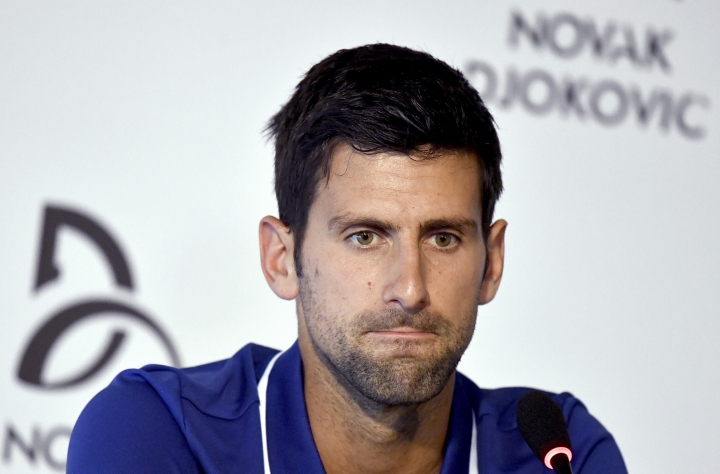 FILE - In this Wednesday, July 26, 2017 file photo, tennis player Novak Djokovic pauses during a press conference in Belgrade, Serbia. Novak has withdrawn from the Mubadala WTC exhibition event due to pain in his right elbow. The Serbian star was scheduled to return to tennis on Friday, Dec. 29, 2017 after being out of the game for nearly six months.(Andrej Isakovic, Pool Photo via AP, File)