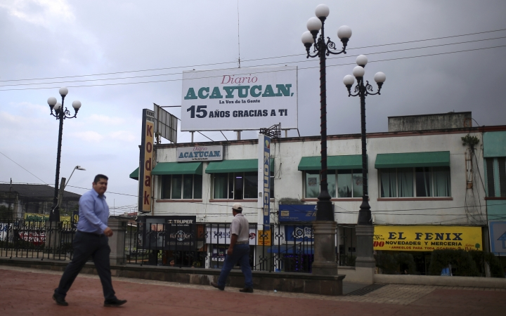 """In this Dec. 21, 2017 photo, a man walks past the newspaper """"Diario de Acayucan,"""" or The Acayucan Daily, where slain journalist Gumaro Perez worked in Acayucan, Veracruz state, Mexico. Over the years, Perez contributed stories to several local media outlets and helped found the news website La Voz del Sur. (AP Photo/Felix Marquez)"""