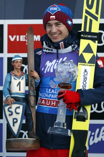 Winner Kamil Stoch of Poland celebrates on the podium after winning the second stage of the 66th four hills ski jumping tournament in Garmisch-Partenkirchen, Germany, Monday, Jan. 1, 2018. (AP Photo/Matthias Schrader)
