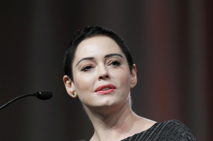 "FILE- In this Oct. 27, 2017, file photo, actress Rose McGowan speaks at the inaugural Women's Convention in Detroit. Actress and activist McGowan will be the subject of a new documentary TV series. E! said Tuesday, Jan. 2, 2017, it will air the first part of ""Citizen Rose"" on Jan. 30, which coincides with the release of her memoir, ""Brave."" (AP Photo/Paul Sancya, File)"