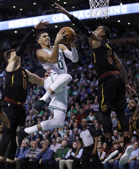 Boston Celtics forward Jayson Tatum (0) drives to the basket against Cleveland Cavaliers guard JR Smith, right, during the second quarter of an NBA basketball game in Boston, Wednesday, Jan. 3, 2018. (AP Photo/Charles Krupa)