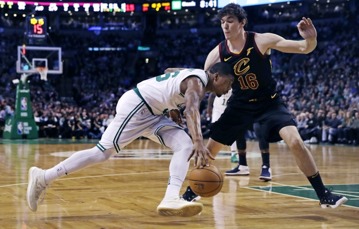Boston Celtics guard Marcus Smart, left, drives to the basket against Cleveland Cavaliers forward Cedi Osman (16) during the second quarter of an NBA basketball game in Boston, Wednesday, Jan. 3, 2018. (AP Photo/Charles Krupa)