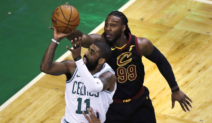 Boston Celtics guard Kyrie Irving (11) drives to the basket past Cleveland Cavaliers forward Jae Crowder (99) during the first quarter of an NBA basketball game in Boston, Wednesday, Jan. 3, 2018. (AP Photo/Charles Krupa)