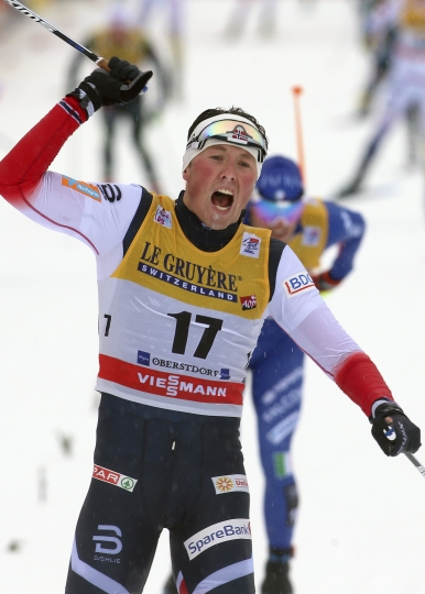 Norway's Emil Iversen celebrates after winning the 15km mass start of the Tour de Ski cross country skiing, in Oberstdorf, Germany, Thursday, Jan. 4, 2018. ( Karl-Josef Hildenbrand/dpa via AP)