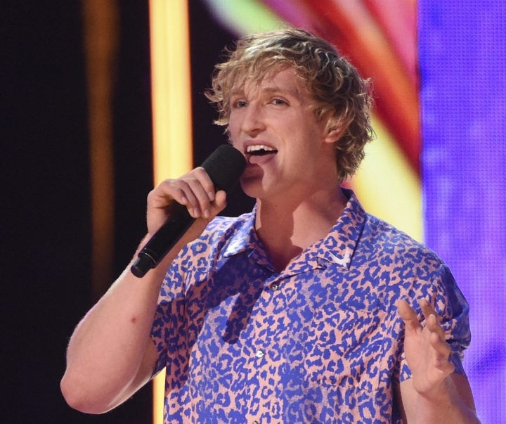 FILE - In this Aug. 13, 2017, file photo, Logan Paul introduces a performance by Kyle & Lil Yachty and Rita Ora at the Teen Choice Awards at the Galen Center in Los Angeles. Paul has issued a more extensive apology for posting a YouTube video showing what appeared to be a body in a Japanese forest known as a suicide destination. The initial video he posted Sunday, Dec. 31, 2017, showed the prolific social media user trekking with friends in the Aokigahara forest near Mount Fuji. He seems aware the forest is sometimes chosen for suicides but is surprised to see what appears to be a body hanging from a tree. (Photo by Phil McCarten/Invision/AP, File)