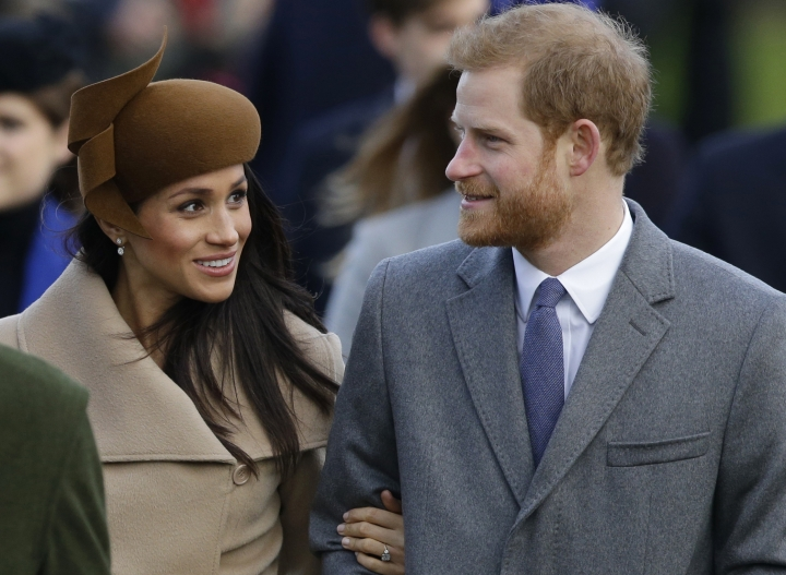 FILE - This is a Monday, Dec. 25, 2017. file photo of Britain'sPrince Harry and his fiancee Meghan Markle as they arrive to attend the traditional Christmas Day service, at St. Mary Magdalene Church in Sandringham, England. A political storm is brewing ahead of Prince Harry's and Meghan Markle's May 19 wedding over whether to crack down on homeless people and beggars in the well-to-do English town of Windsor. (AP Photo/Alastair Grant/File)