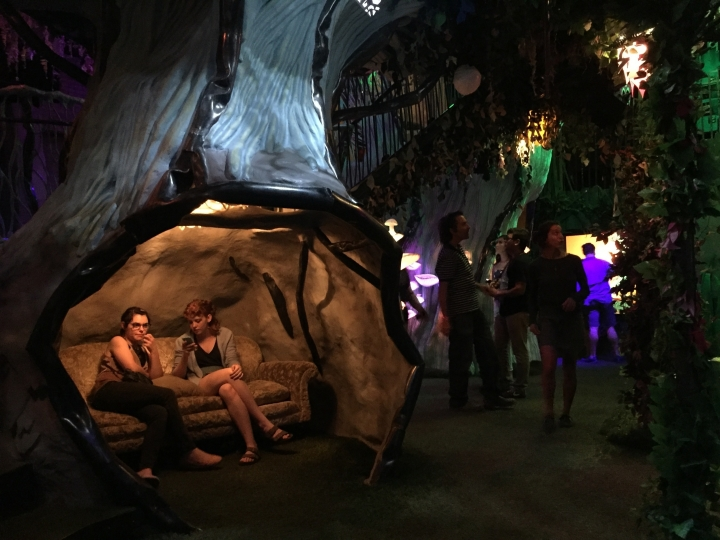 File - In this July 14, 2017, file photo, recent high school graduates Abbigail Deason and Grace Branscum, both 18, of Oklahoma City relax inside Meow Wolf's mazelike exhibition space in Santa Fe, N.M. Creators of a popular immersive art entertainment project in Santa Fe, N.M, are expanding to a major metropolitan market with plans for an interactive exhibit and music venue on a wedge of highway-side property in an industrial stretch of downtown Denver. (AP Photo/Morgan Lee, File)