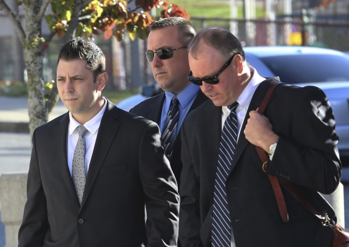 FILE- In this Nov. 7, 2016, file photo, Anthony Carelli, left, arrives to court in White Plains, N.Y. The civil rights probe into the death of a mentally ill black man who accidentally set off his emergency medical alert device and was fatally shot by Carelli, a suburban New York police officer who responded, has been closed without charges. Acting U.S. Attorney Joon Kim said in a statement Thursday, Jan. 4, 2018, that there was insufficient evidence for criminal charges in the shooting of Kenneth Chamberlain. (AP Photo/Seth Wenig, File)