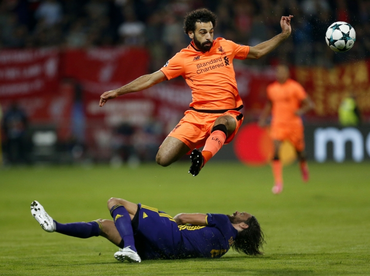 FILE - In this Oct. 17, 2017 file photo, Liverpool's Mohamed Salah, top, duels for the ball with Maribor's Marko Suler during the Champions League soccer match between Maribor and Liverpool, in Maribor, Slovenia. Salah, one of the hottest soccer players in the world right now, was once rejected by his local team. That he succeeded anyway is being latched onto by fellow Egyptians as a sign of hope for a country for years mired bypolitical instability and violence, deadly terrorist attacks and an economic crisis. (AP Photo/Darko Bandic, File)