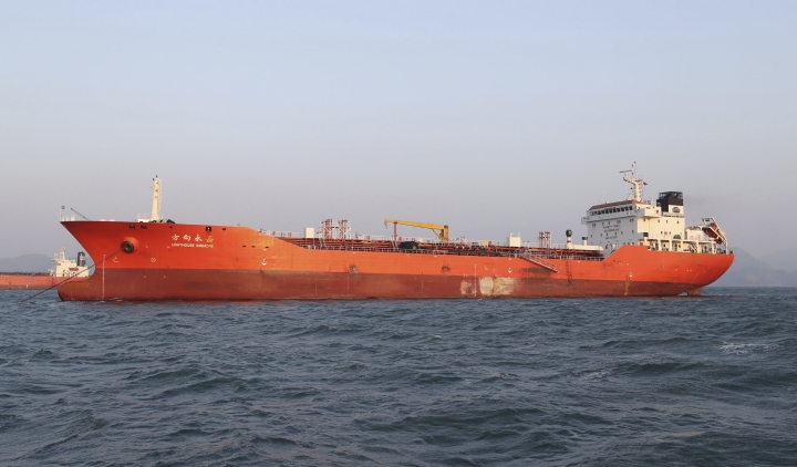 FILE - In this Friday, Dec. 29, 2017, file photo, the Lighthouse Winmore, a Hong Kong-flagged ship, is seen in waters off Yeosu, South Korea. Prosecutors in Taiwan say they are investigating a man suspected of involvement in illegal oil sales after reports last week that South Korean authorities seized the Hong Kong-flagged, Lighthouse Winmore ship for violating U.N. sanctions by selling oil to North Korea and that a Taiwan company was involved. (Hyung Min-woo/Yonhap via AP, File)