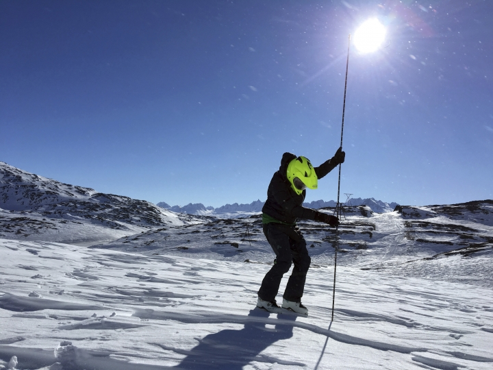 This April, 2017, photo provided by the Alaska Division of Geological and Geophysical Surveys shows geologist Katreen Wikstrom Jones using an avalanche probe to measure snow depth at Thompson Pass, Alaska. Researchers in the Pacific Northwest and Alaska are looking for backcountry enthusiasts who want to aid a science mission. A program funded by NASA is recruiting citizen scientists to measure snow levels in mountain terrain. (Gabriel Wolken/Alaska Division of Geological and Geophysical Surveys via AP)