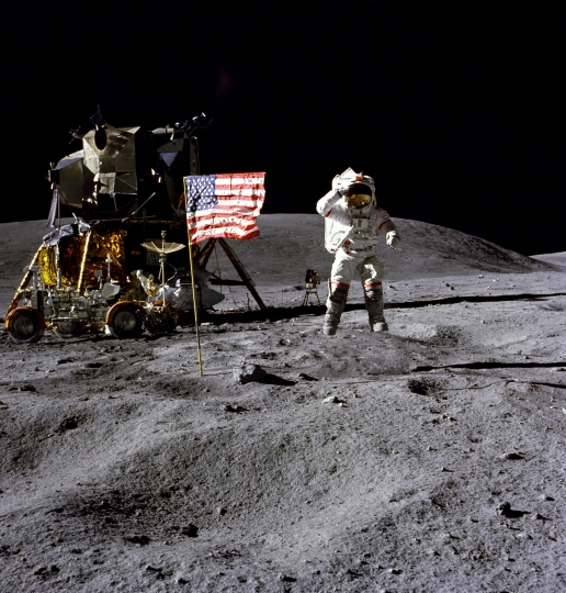In this April 1972 photo made available by NASA, John Young salutes the U.S. flag at the Descartes landing site on the moon during the first Apollo 16 extravehicular activity. NASA says the astronaut, who walked on the moon and later commanded the first space shuttle flight, died on Friday, Jan. 5, 2018. He was 87. (Charles M. Duke Jr./NASA via AP)