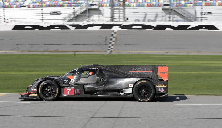 In this Friday, Jan. 5, 2018 photo, the Penske team Acura DPI heads down pit road during testing for the IMSA 24 hour auto race at Daytona International Speedway in Daytona Beach, Fla. Drivers for the team will be Helio Castroneves, of Brazil, Graham Rahal and Ricky Taylor. (AP Photo/John Raoux)