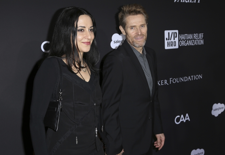 Giada Colagrande, left, and Willem Dafoe arrive at the 2018 Sean Penn J/P Haitian Relief Organization Gala at the Milk Studios on Saturday, Jan. 6, 2018, in Los Angeles. (Photo by Willy Sanjuan/Invision/AP)