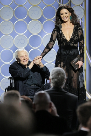 This image released by NBC shows presenters Kirk Douglas, left, and Catherine Zeta Jones at the 75th Annual Golden Globe Awards in Beverly Hills, Calif., on Sunday, Jan. 7, 2018. (Paul Drinkwater/NBC via AP)
