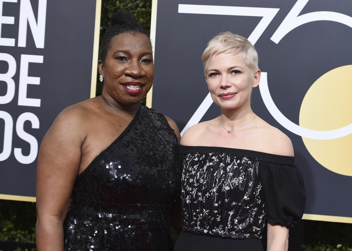 Tarana Burke, left, and Michelle Williams arrive at the 75th annual Golden Globe Awards at the Beverly Hilton Hotel on Sunday, Jan. 7, 2018, in Beverly Hills, Calif. (Photo by Jordan Strauss/Invision/AP)