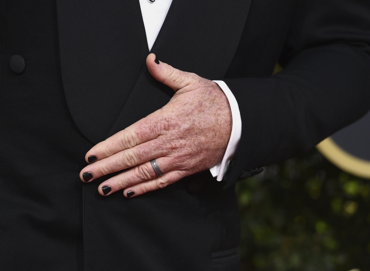 Chris Sullivan wears black nail polish as he arrives at the 75th annual Golden Globe Awards at the Beverly Hilton Hotel on Sunday, Jan. 7, 2018, in Beverly Hills, Calif. (Photo by Jordan Strauss/Invision/AP)