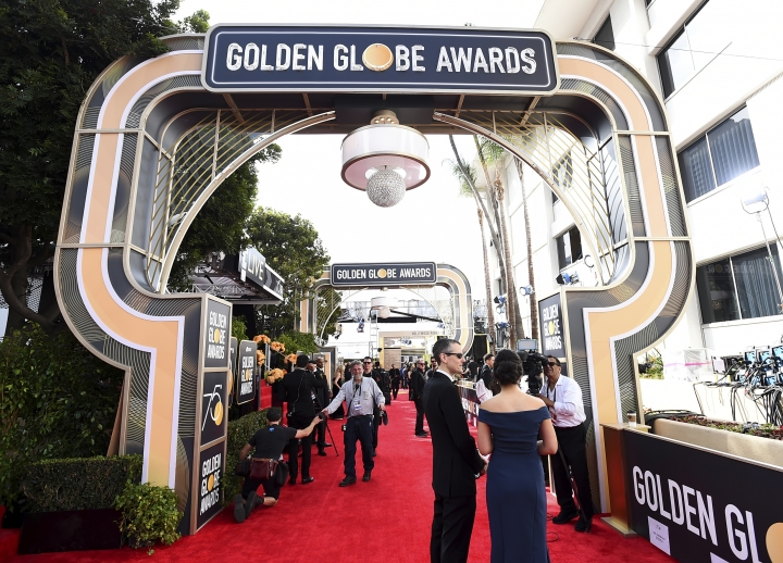 Media and crew prepare on the red carpet at the 75th annual Golden Globe Awards at the Beverly Hilton Hotel on Sunday, Jan. 7, 2018, in Beverly Hills, Calif. (Photo by Jordan Strauss/Invision/AP)